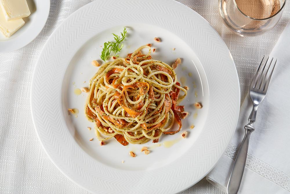 Bucatini with Hazelnut and Carrot Top Pesto, Charred Carrot Skins and Pecorino Romano